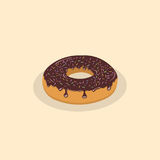 Donut with chocolate icing and sprinkles Stock Images