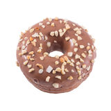 Donut in chocolate with nuts. A single chocolate glazed donut with nuts isolated white background top view Royalty Free Stock Photos