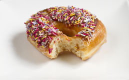 Donut with chocolate and sprinkles Royalty Free Stock Photos