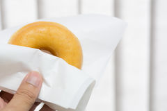Donut. Close up hand hold a donut Royalty Free Stock Photography