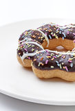 Donut   close up. Donut on white dish close up Royalty Free Stock Image