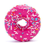 Donut coated with a pink frosting and sprinkles of different col Royalty Free Stock Image