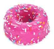 Donut coated with a pink frosting and sprinkles of different col Royalty Free Stock Photos