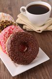 Donut and coffee Stock Images