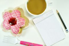 Yummy Donut, lovely notepad and coffee royalty free stock images