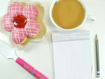 Lovely Message. A Delicious Donut , Notepad, Pencil, Fork royalty free stock image