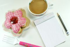 Yummy Donut, lovely notepad and coffee royalty free stock photos