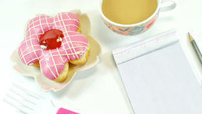 Yummy Donut, lovely notepad and coffee stock photography