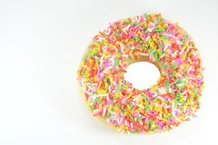 Donut with Colored Rice Sprinkle. Isolated on a White Background Royalty Free Stock Photography