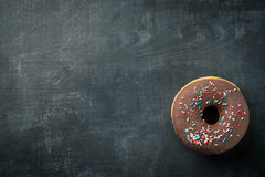 Donut with colorful sprinkles Royalty Free Stock Image