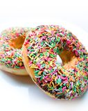 Donut covered i chocolate icing and colourful spri Royalty Free Stock Images