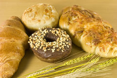 Donut and croissants. Croissant, donuts, with wheat leaves Royalty Free Stock Photo
