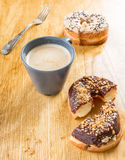 Donut cronut on a wodden table Royalty Free Stock Image