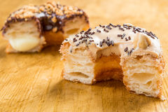 Donut cronut on a wodden table Stock Photos