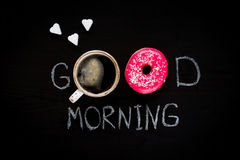 Donut, cup of coffee and heart shaped sugar cubes. Breakfast for beloved Stock Photography