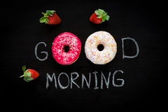 Donut, cup of coffee and strawberries. Breakfast for beloved Stock Photos