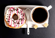 Donut and cup of coffee Stock Photos