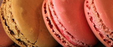 Macaron. Delicious dessert donut colorful pink and brown Stock Photos
