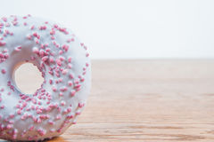 Donut, delicius. Delicious and unhealthy donut lying on a table ready to eat Royalty Free Stock Images