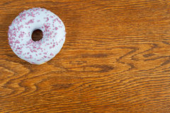 Donut, delicius. Delicious and unhealthy donut lying on a table ready to eat Stock Photography