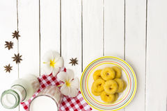 Donut dessert and milk bottle and milk glass  on Red checkered fabric .Meal or breakfast hi-vitamin and calcium. 1 Royalty Free Stock Photo
