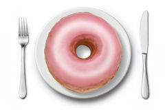 Donut Diet Junk Food. A pink donut on a plate with a knife and fork Royalty Free Stock Images