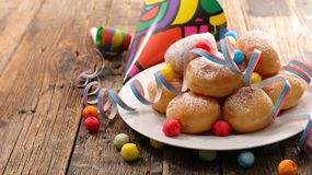 Donut. With carnival decoration on wood Stock Images