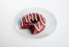donut or donut with missing bite on a background. Stock Photo