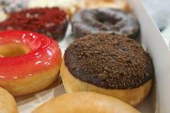Donut or doughnut. In the box Royalty Free Stock Photos
