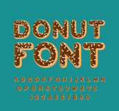 Donut font. pie alphabet. Baked in oil letters. Chocolate icing Royalty Free Stock Images