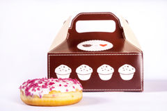 Donut in front of box. Isolated on white doughnut with pink sprinkles Stock Photography