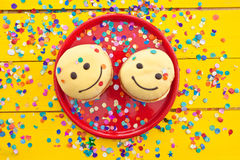 Donut with funny smiley face. Donut with yellow frosting and a funny smiley face royalty free stock photo