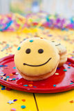 Donut with funny smiley face Stock Photography