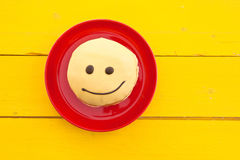 Donut with funny smiley face Stock Photo
