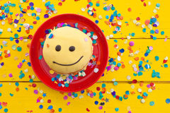 Donut with funny smiley face Stock Images