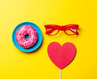 Donut, glasses and toy Stock Image