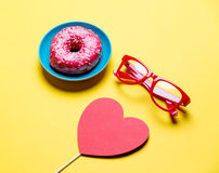 Donut, glasses and toy Stock Images