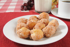 Donut holes. A plate of donut holes with coffee and milk Royalty Free Stock Photo