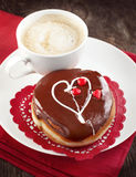 Donut with icing hearts and cup of coffee Royalty Free Stock Photos