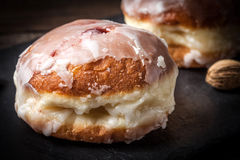 Donut with icing and rose jam. Royalty Free Stock Photography