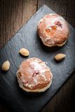 Donut with icing and rose jam. Royalty Free Stock Photo