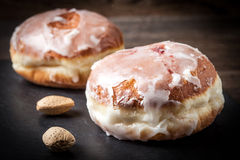 Donut with icing and rose jam. Stock Photography