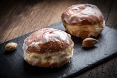 Donut with icing and rose jam. Dark light stock photo