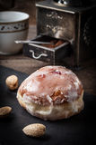 Donut with icing and rose jam. Royalty Free Stock Photos