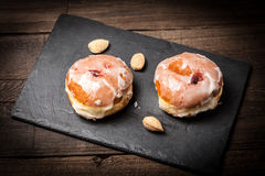 Donut with icing and rose jam. Stock Images
