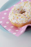 Donut with icing and sprinkles Royalty Free Stock Image