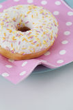 Donut with icing and sprinkles Stock Photos