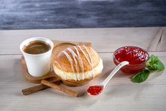 Donut with jam and coffee Stock Photos