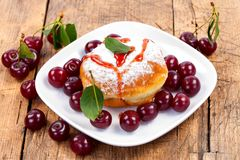 Donut with jam and fruits Stock Photos