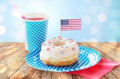 Donut with juice and american flag decoration Stock Photos